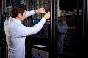 IT Technician Reparing Data Drives